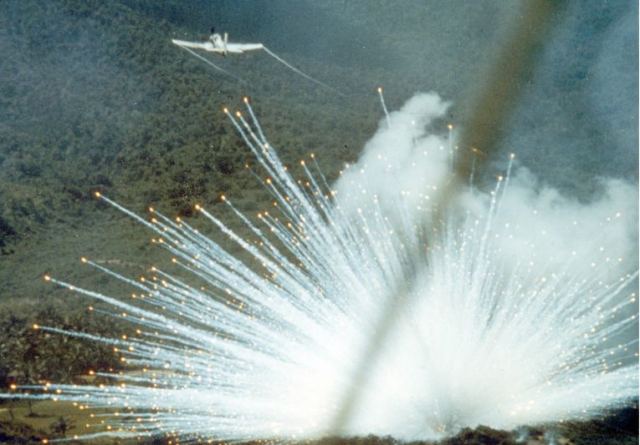 A U.S. Air Force plane drops a white phosphorus bomb on Vietnam in 1966.